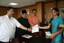 Muzam Khan submitting a memorandum to HM