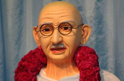 Mahatma Gandhi insulted with Quarter Bottles