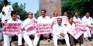 Suspended TRS MLAs continue protest at Martyrs Memorial